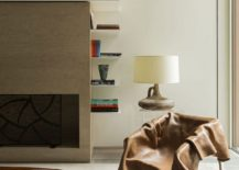 Acrylic side table, custom chair and table lamp give the loving room a chic modern style
