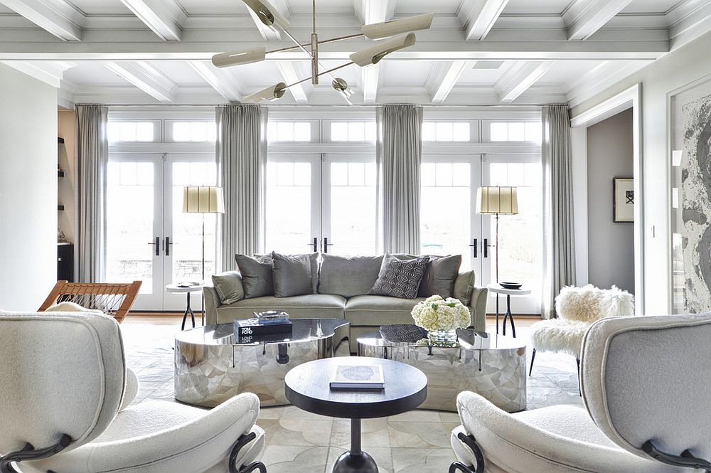 All-white living room with glittering coffee tables [Design: Tamara Magel Studio]