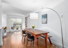 Arco floor lamp-styled lighting fixture illuminates the dining area