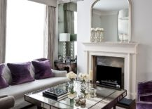 Art Deco living room with splashes of purple and mirrored coffee table