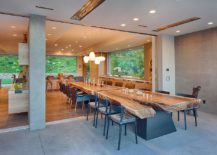 Awesome 24 foot suar slab dining table creates a marvelous indoor and outdoor dining space [Design: Matrix Design]