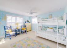Beach style kids' room in blue with a hint of yellow