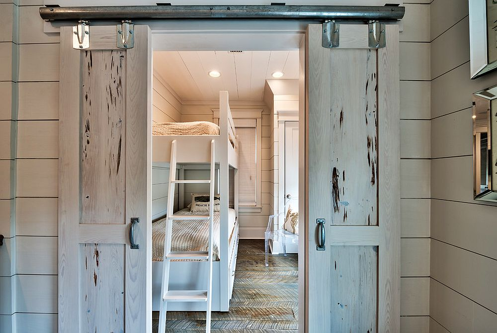 Beach style kids' room with small sliding barn doors [Design: Henderson Development and Design / Tim Kramer Photography]