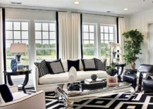 Black-white-and-blue-shape-a-refined-family-room-with-mirrored-coffee-table-217x155