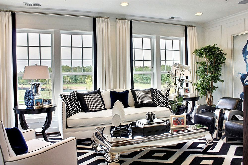 Black, white and blue shape a refined family room with mirrored coffee table [Design: M/I Homes]