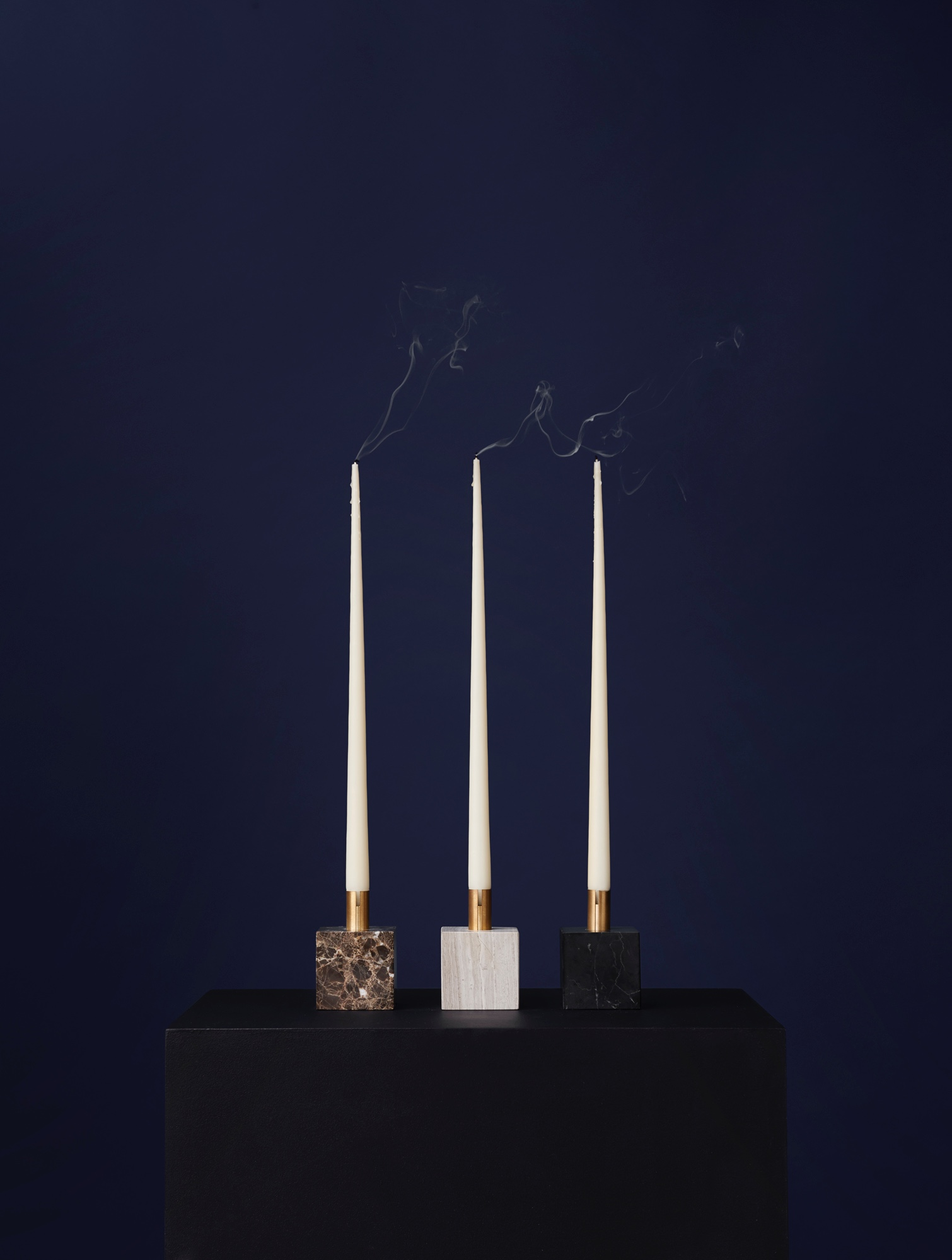 Block Candle Holders designed by Malene Birger. Polished brass stem with marble base.
