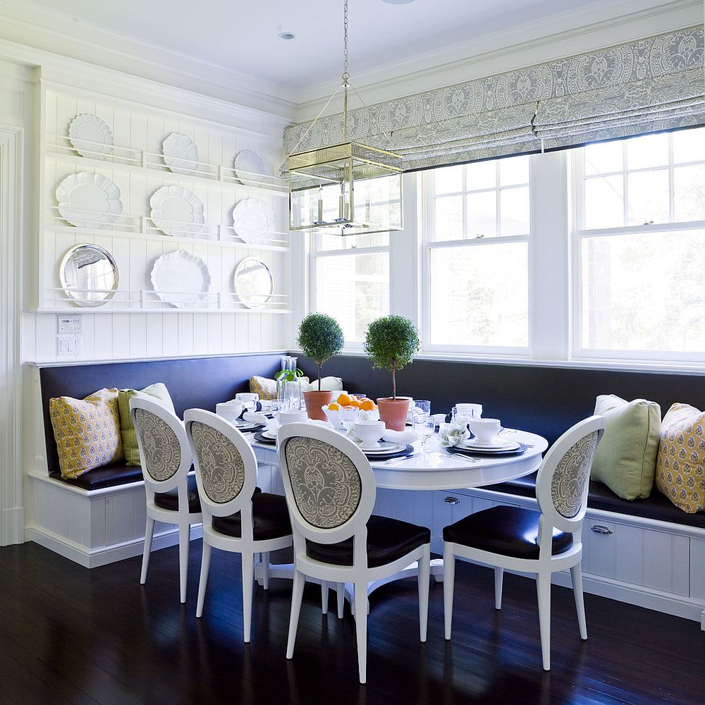 Blue and white banquette dining with built-in storage underneath [Design: Thornton Designs]