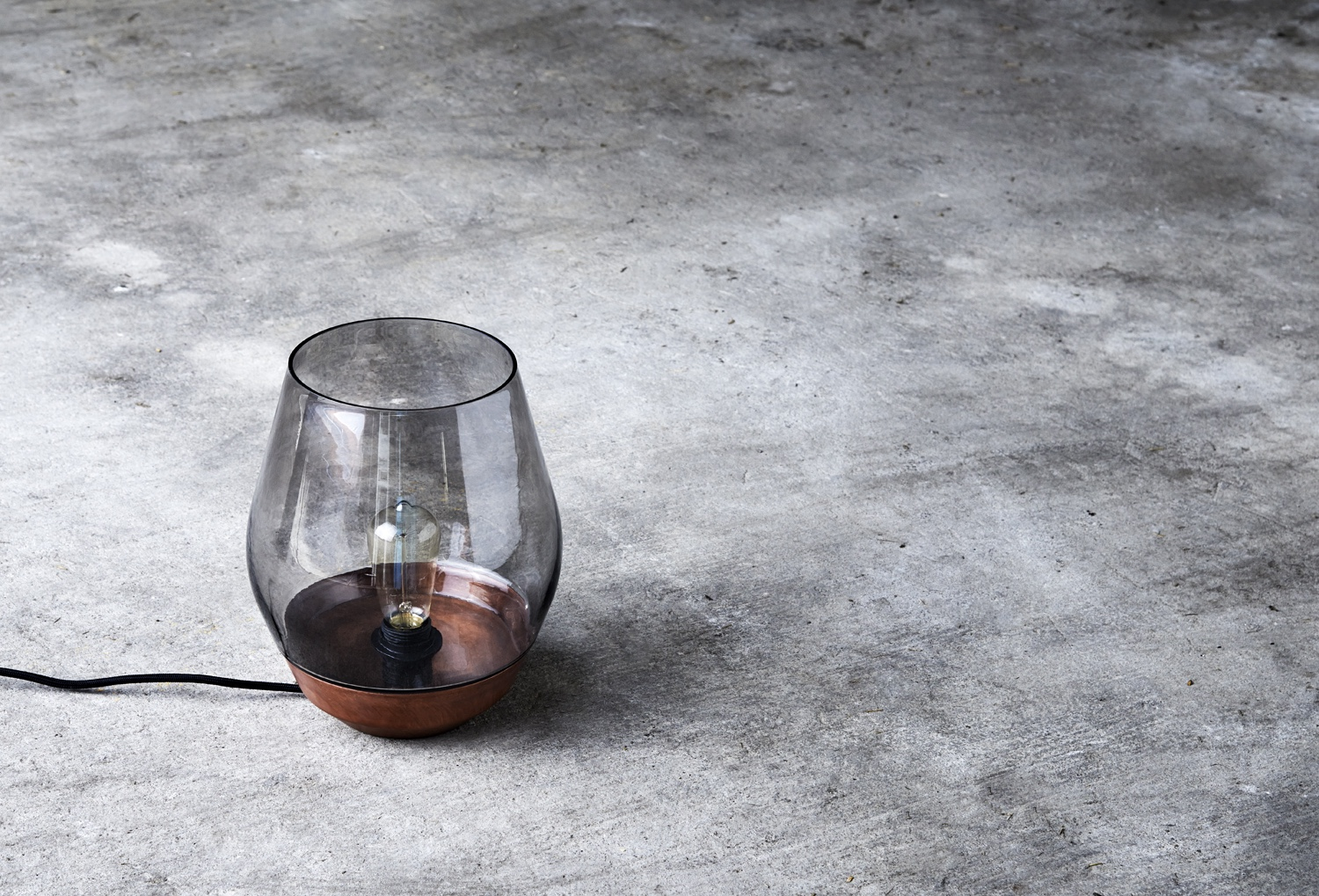 Bowl Table Lamp designed by Knut Bendik Humlevik. Shown in raw copper with light smoked glass. This design is inspired by a traditional lantern shape.