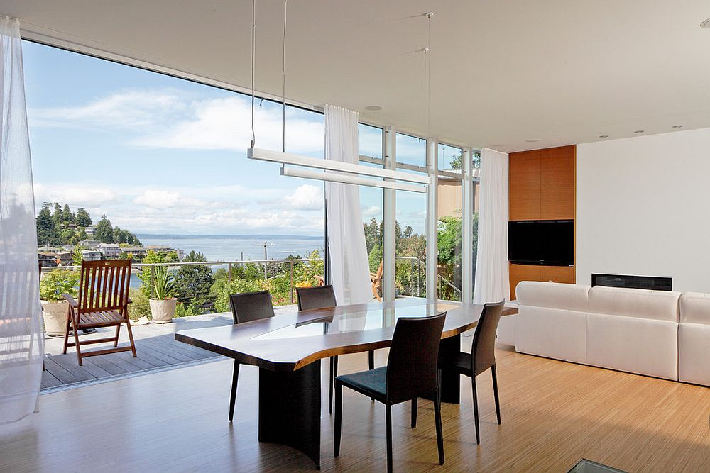Breezy dining space opens up to the view outside [From: Prentiss Balance Wickline Architects / Alex Hayden Photography]