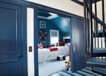 Bright blue barn style door for the modern nautical themed kids room