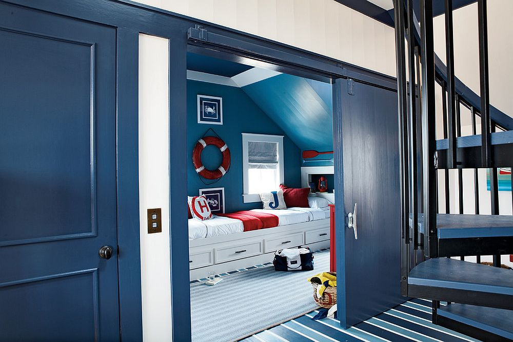 Bright blue barn style door for the modern nautical themed kids room [From: Our Town Plans / Coastal Living]