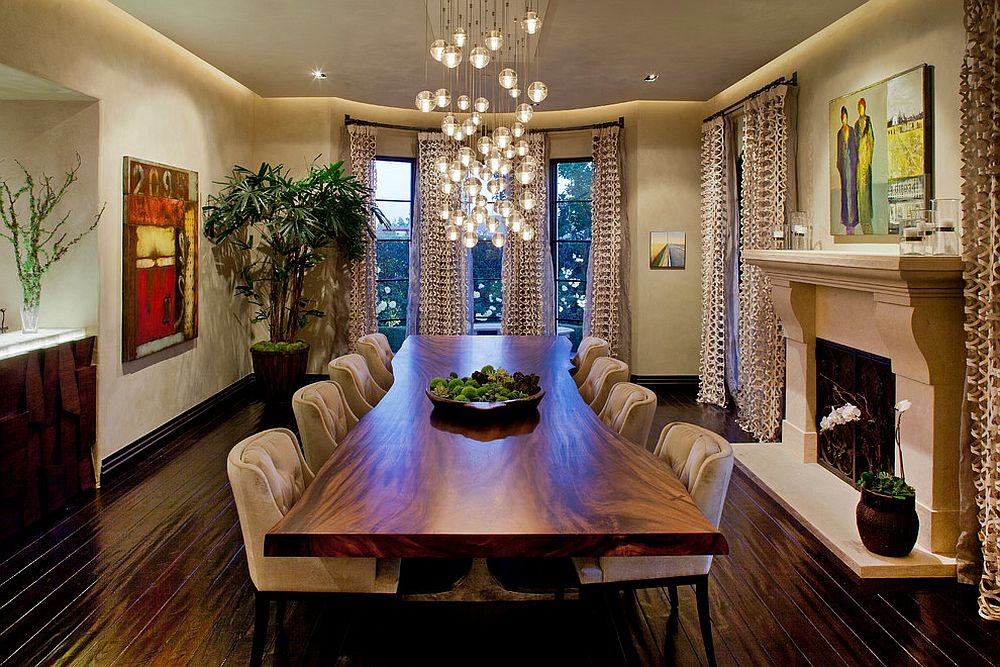 Cascading chandelier coupled with live edge table in the dining room