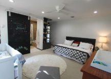 Chalkboard-sliding-barn-door-also-serves-as-a-message-board-in-the-kids-room-217x155