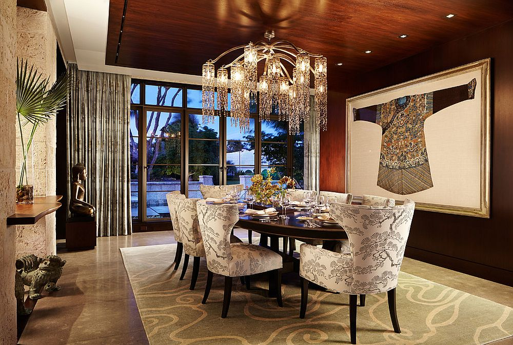 Chandelier and wall art bring opulence to the beautifully lit dining room [Design: Mary Washer Designs]