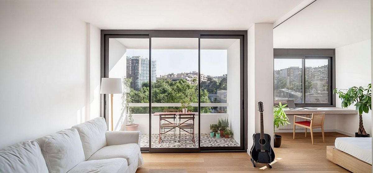 Cheerful modern Barcelona apartment in white Sliding Doors Alter the Dynamics of Light Filled Barcelona Apartment
