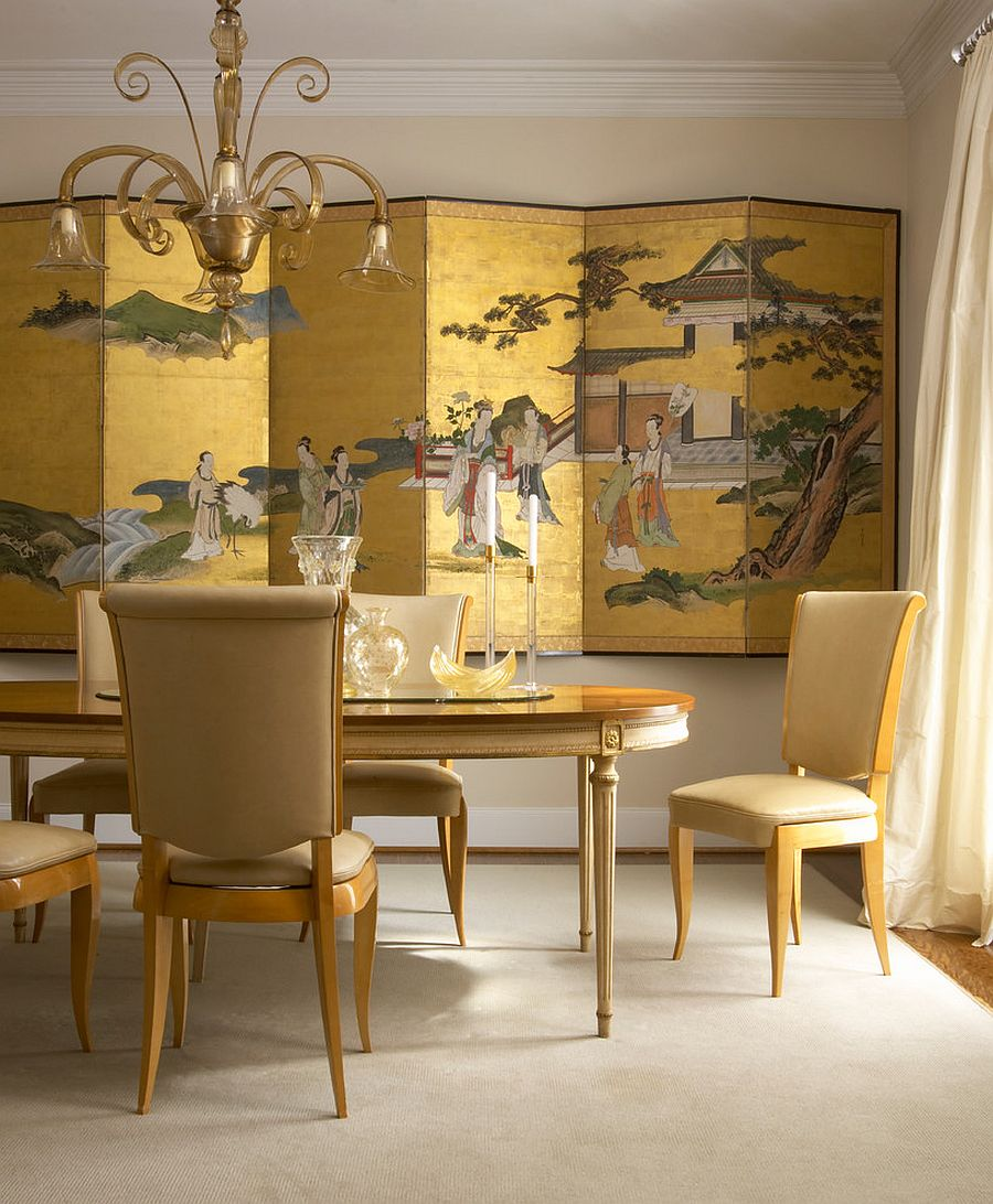 Chinese decorative screen in gold creates a dramatic backdrop for the dining room in gold [Design: Designers House]