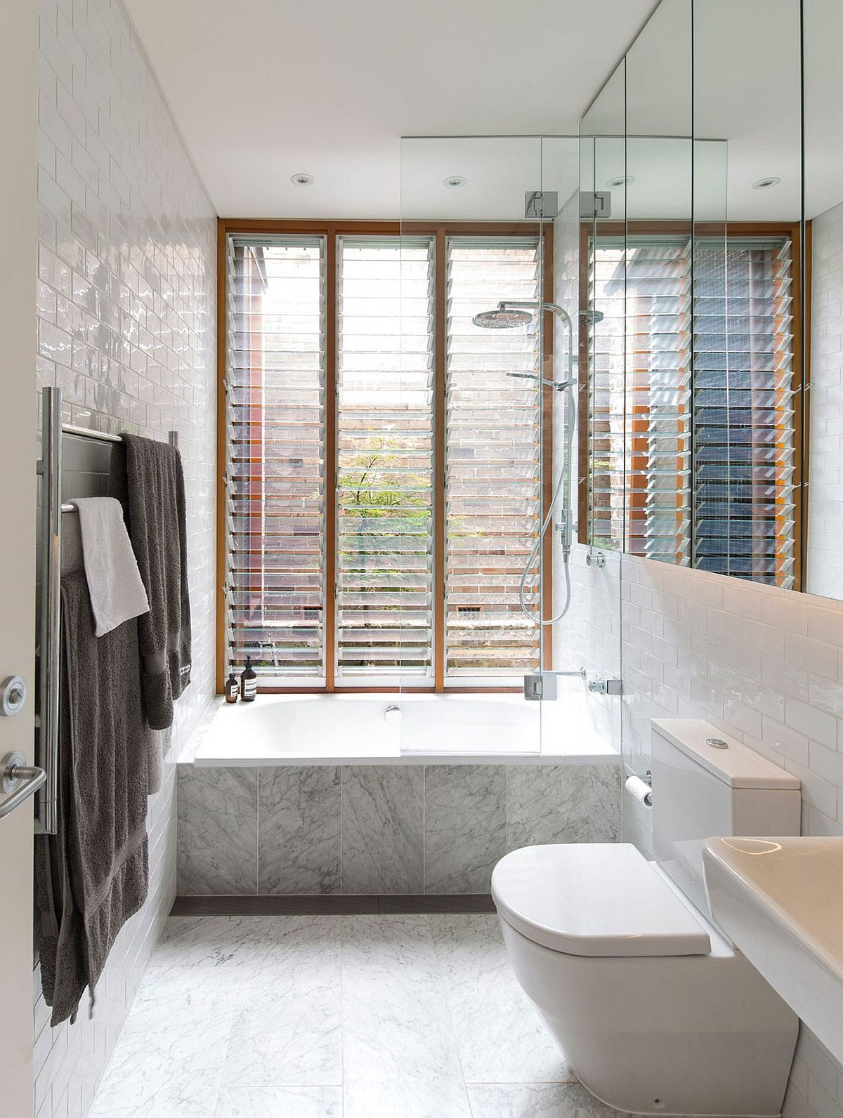 Contemporary bathroom in white with a large window