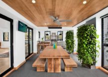 Contemporary dining room with vertical gardens