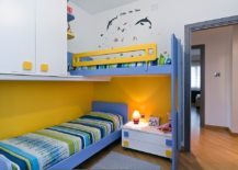 Contemporary kids' room with space-saving bunk beds and ample storage space