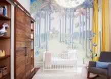 Contemporary nursery uses the barn door for the closet