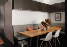 Corner banquette dining with comfortable seating and a live edge table [Design: Tamara Hubinsky Interiors]