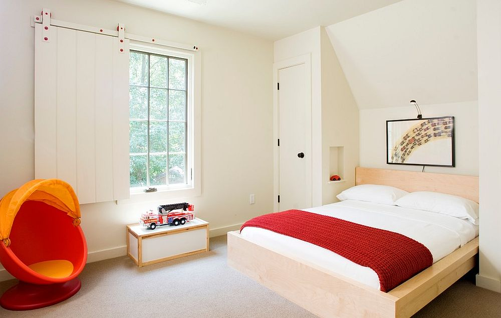 Creative kids' bedroom uses the sliding barn-style door as a window [Design: David Anderson Architect]