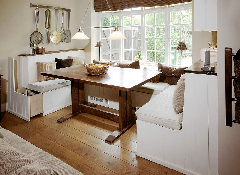 Custom built large pull-out storage units underneath the banquette [Design: Pearce & Co. Woodsmiths]