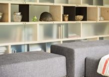Custom cabinetry in the living room and reading space with frosted glass doors