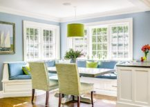 Custom zinc table and a sunny corner banquette create a great gathering spot for the entire family 217x155 Space Saving Design: 25 Banquettes with Built in Storage Underneath