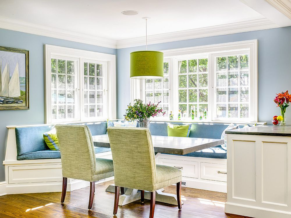 Custom zinc table and a sunny corner banquette create a great gathering spot for the entire family! [Design: Robert A. Cardello Architects]