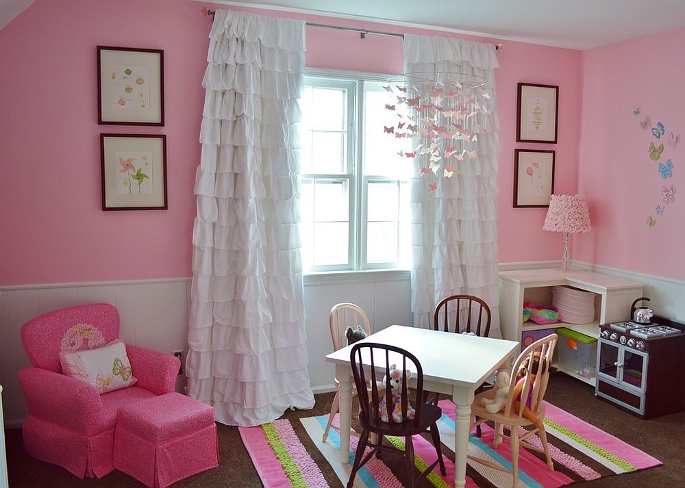 Cute play zone in the girls' bedroom draped in pink [Design: Coastal Decor, Nicole Rice]