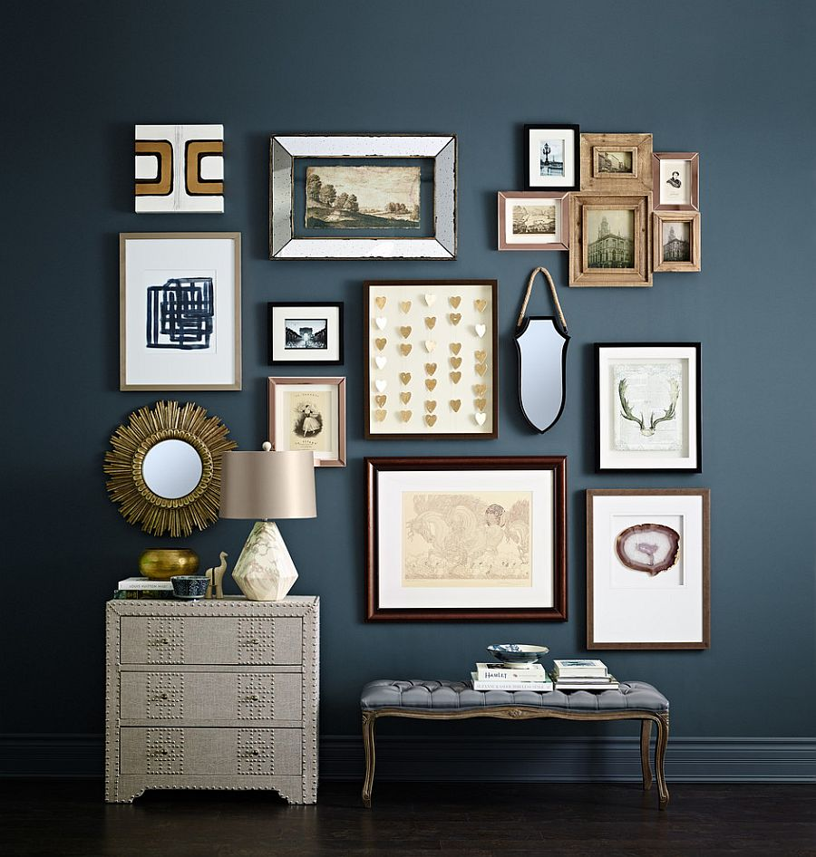 Dark blue is the perfect backdrop for a stunning entry gallery wall