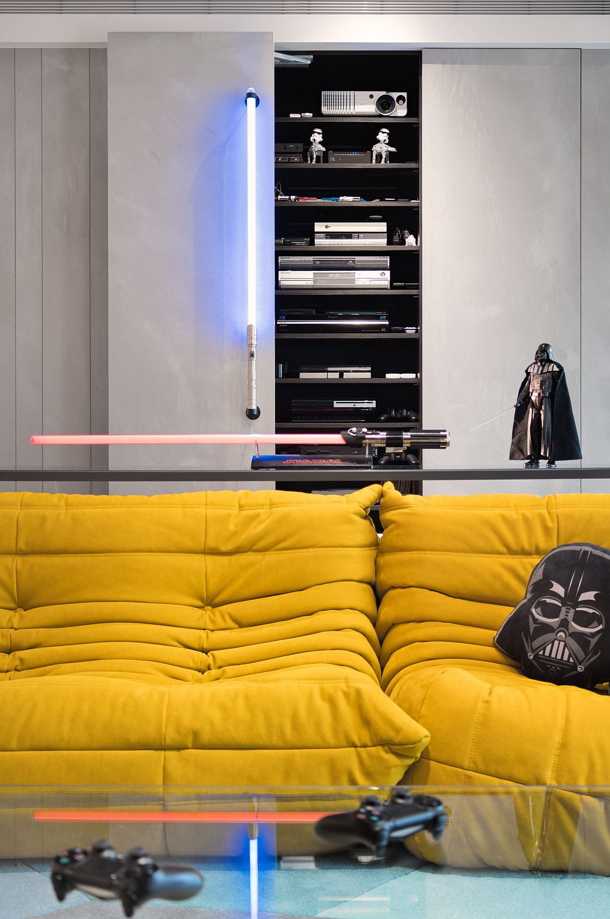 Darth Vader and light saber style lighting rules the living room of the Star Wars home