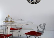 Dining area has a distinct midcentury modern appeal thanks to the Tulip table with marble top