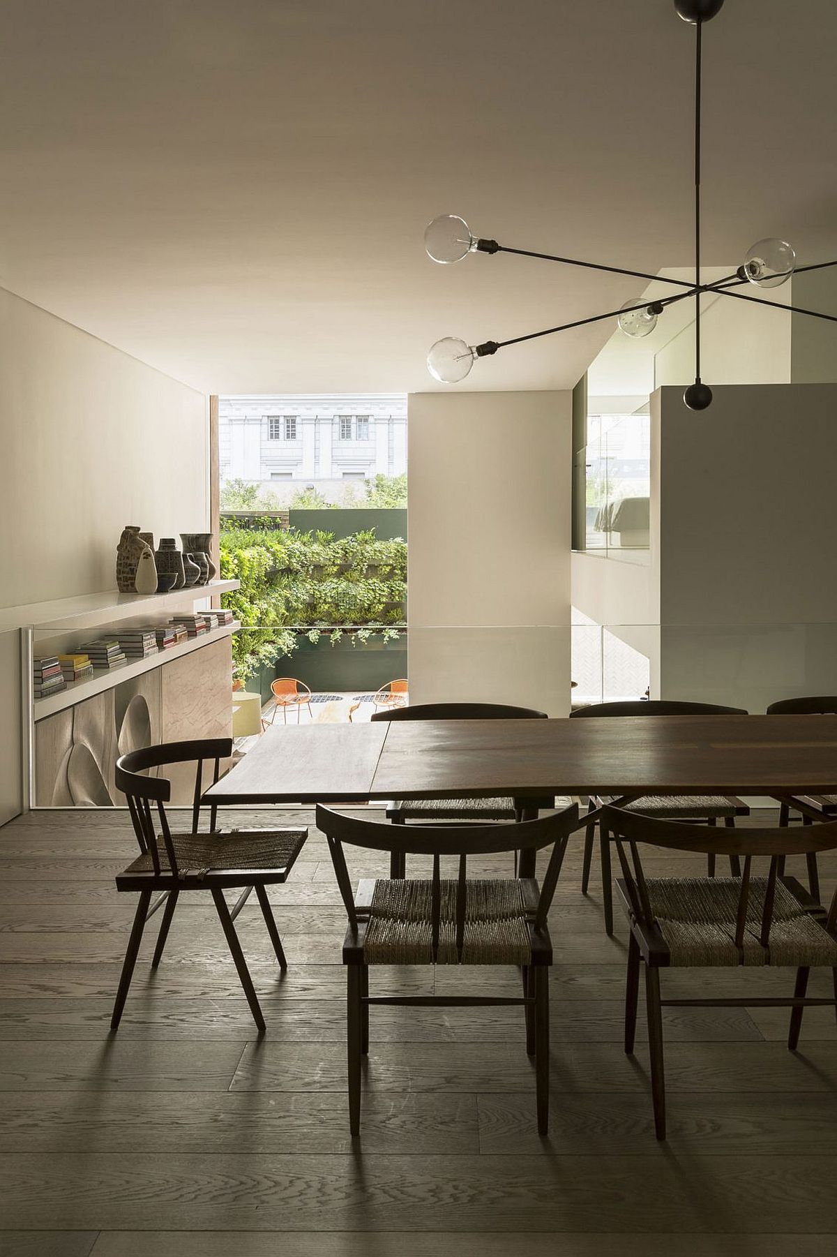 Dining room on mezzanine level overlooking the lower level living area