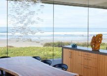 Dining-room-with-an-ocean-view-cascading-chandelier-and-a-live-edge-dining-table-217x155
