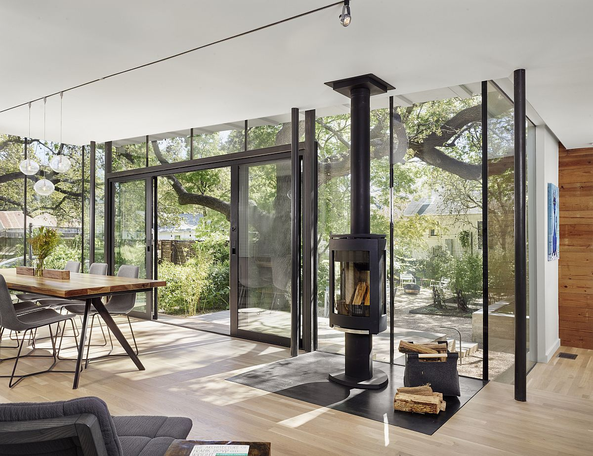 Modern cottage extension with exterior terraces by nick deaver architect view in gallery dining room with glass walls and sliding glass door connected with the patio and outdoor living planetlyrics Images