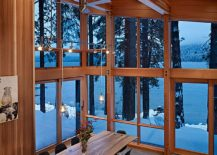 Double height dining room of the cabin retreat with natural edge dining table [Design: DeForest Architects]