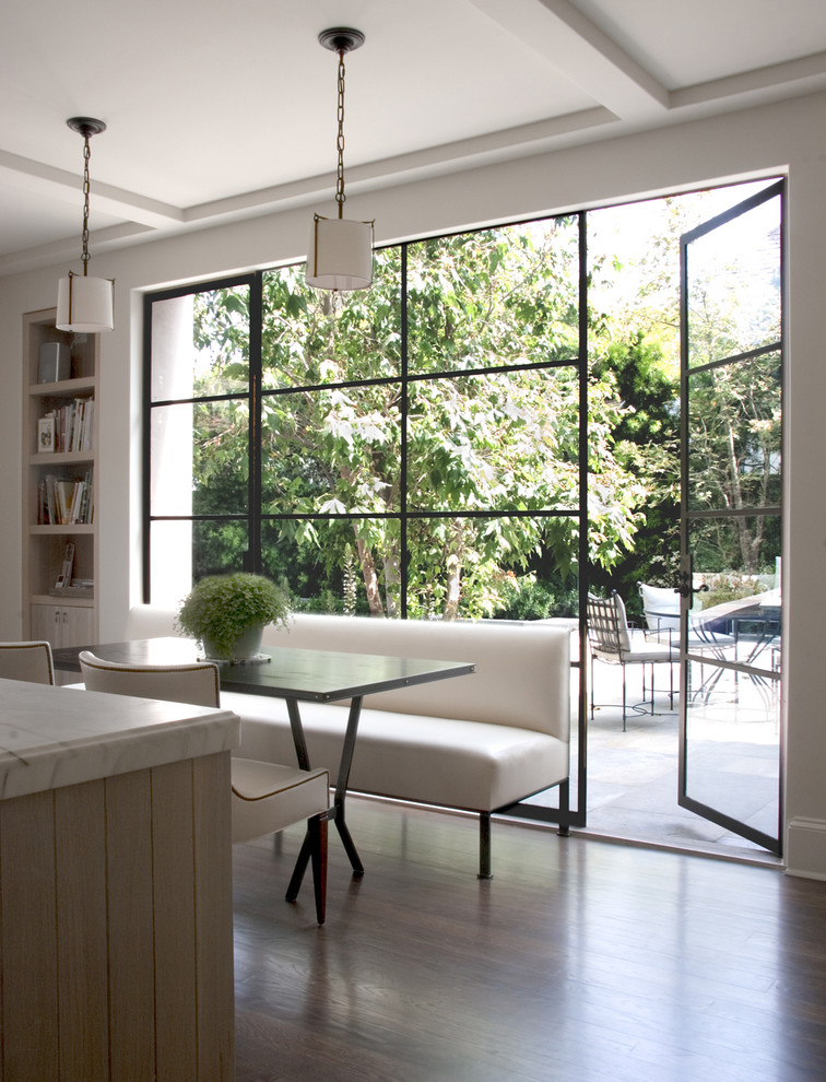 Eating area in a kitchen with floor-to-ceiling windows