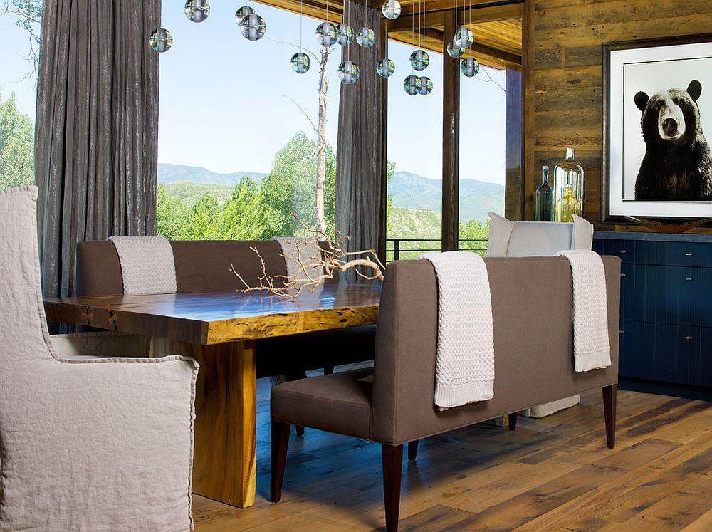 Eclectic dining room with a woodsy cabin vibe and a natural edge table [Design: Slifer Designs]