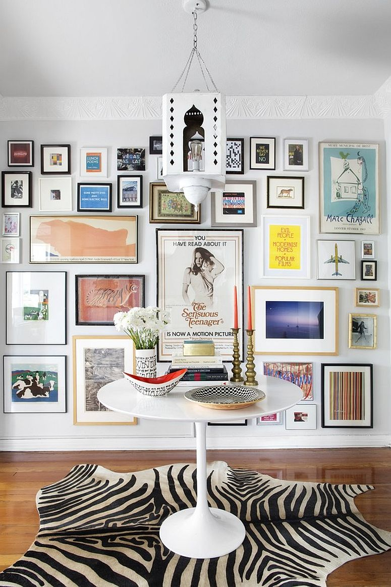Eclectic entry with a gorgeous gallery wall [From: Burnham Design]
