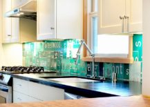 Eclectic kitchen with backsplash crafted from street signs