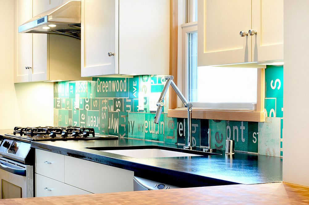 Eclectic kitchen with backsplash crafted from street signs [Design: Fivedot]