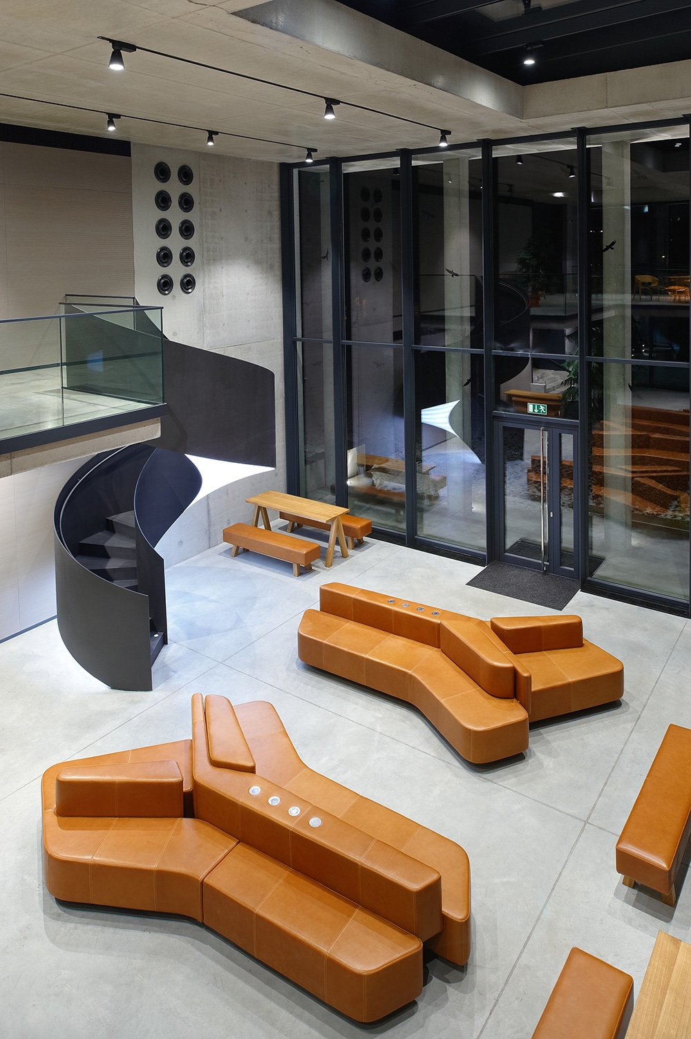 Economics Faculty of Czech University of Life Science in Prague by Luka Križek / IO Studio. Leather: Canyon in cognac.