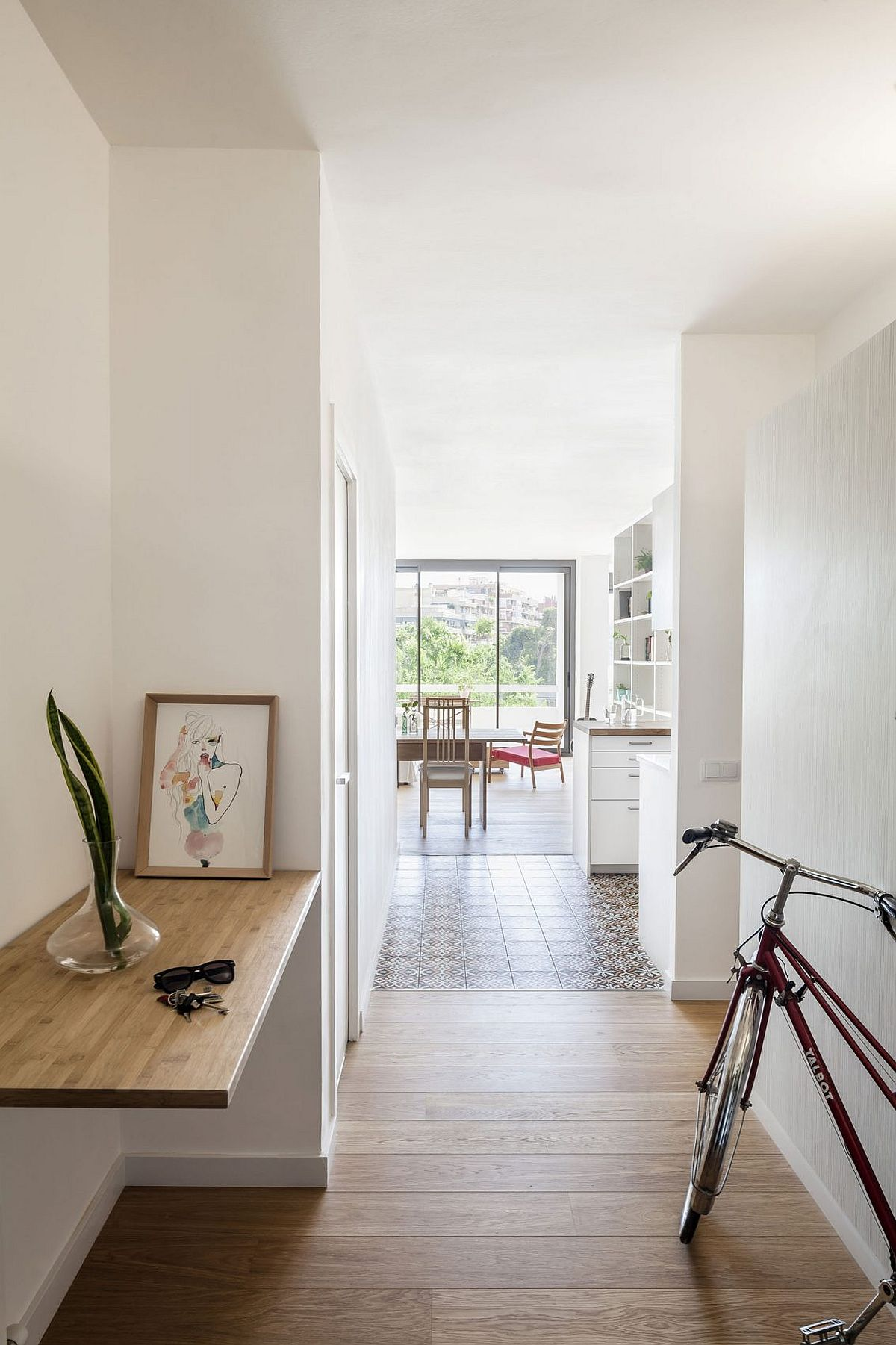 Entry of the small Barcelona apartment renovated to create a more modern living atmosphere