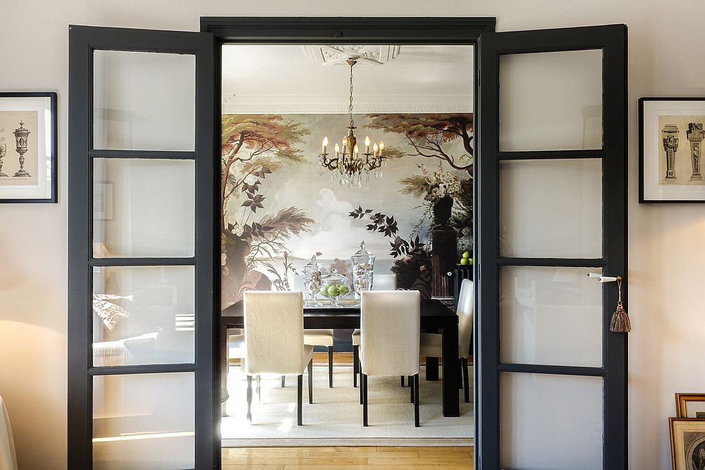 Entry to the Asian dining room with black framed doors [Design: Caron&Associés]