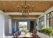 Expansive Mediterranean dining room with natural-edge dining table [Design: David Howell Design]