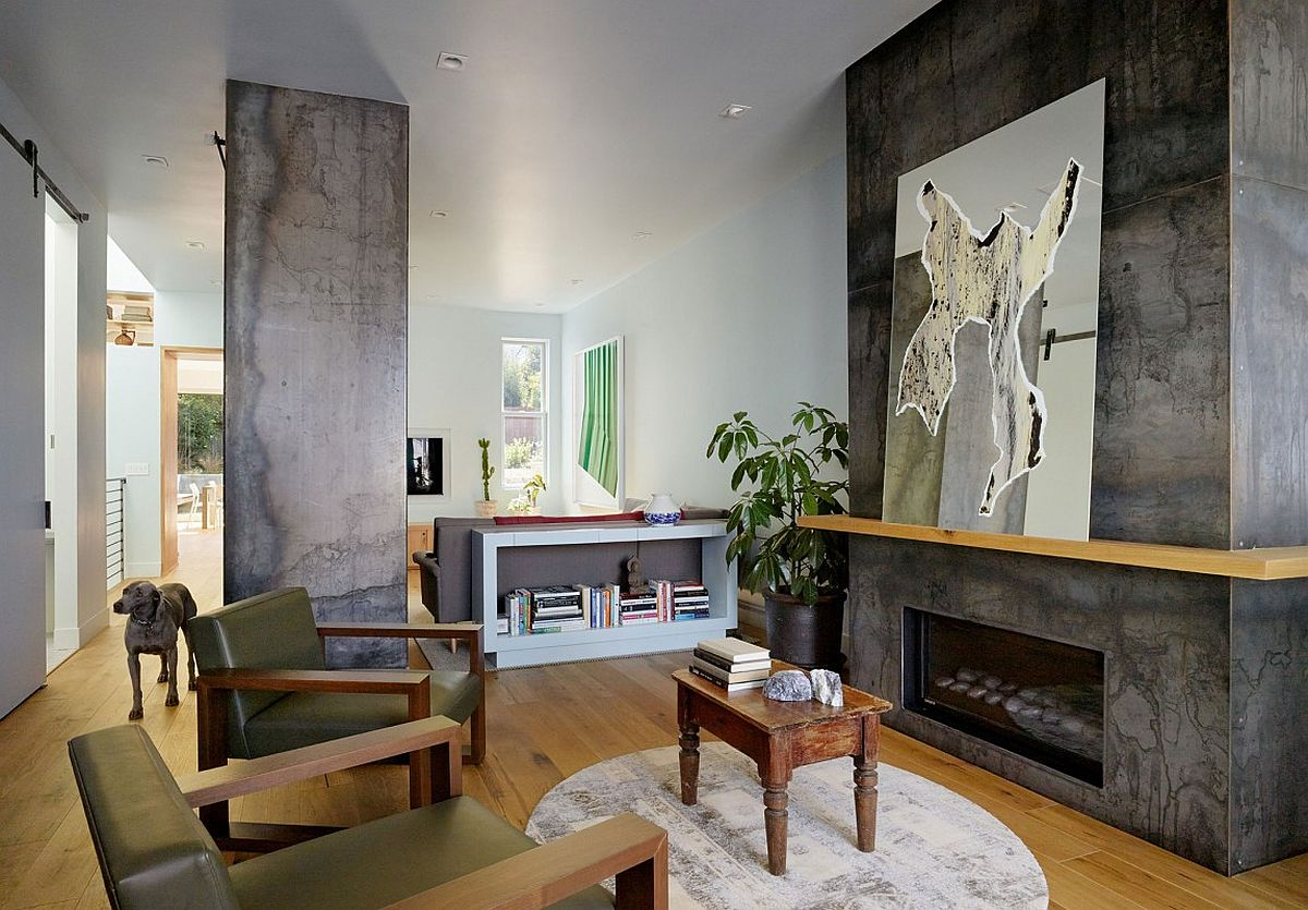 Exposed concrete surfaces add textural contrast to the modern interior of the Noe Valley House