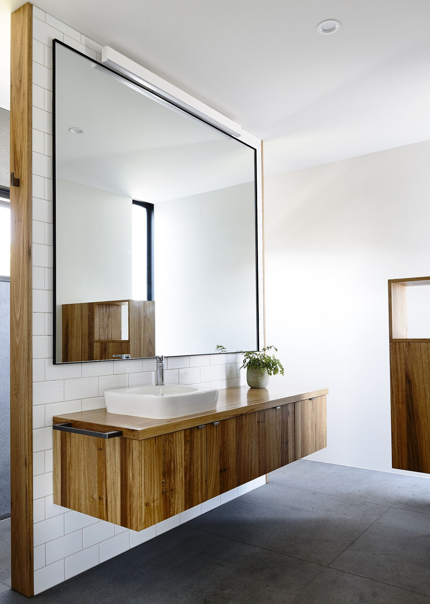 Fabulous floating vanity in wood with giant mirror above