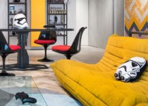 Fabulous sofas in bright yellow add a fun focal point to the open living room